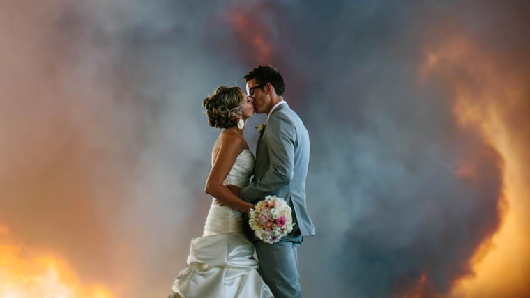 Photographer Josh Newton captured these images of April Hartley and Michael Wolber with a blazing wildfire as their backdrop.