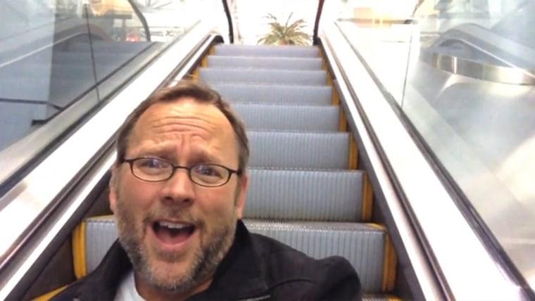 Richard Dunn lip-synching in airport