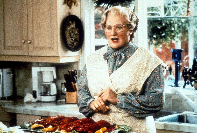 Robin Williams in the kitchen in a scene from the film 'Mrs. Doubtfire'