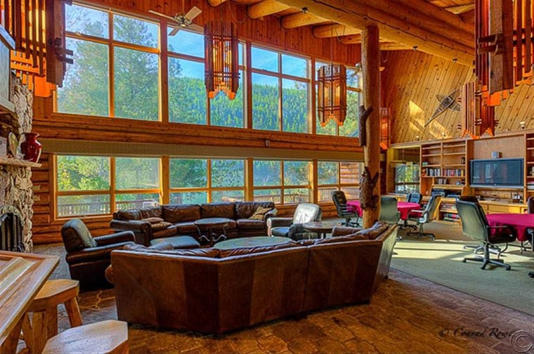 The log-cabin style retreat features 11 guest suites with private baths and a great room large enough for 30 guests.