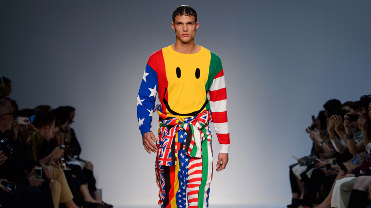 """A model wears a design from the Moschino presentation on the second day of the Spring/Summer 2015 """"London Collections: Men"""" fashion event in London on..."""