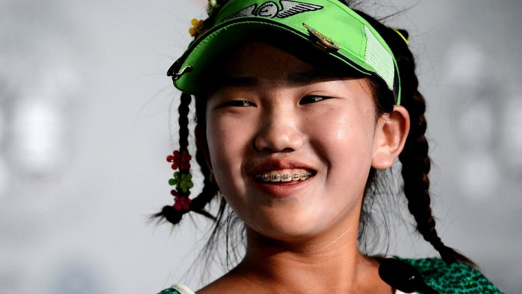 June 17, 2014 - Pinehurst, NC, USA - Lucy Li, 11, answers questions from the media during a press conference for the U.S. Women's Open Championship at...