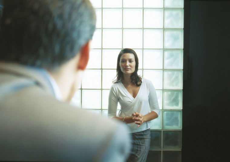 Woman standing, facing man in suit (PhotoAlto via AP Images)