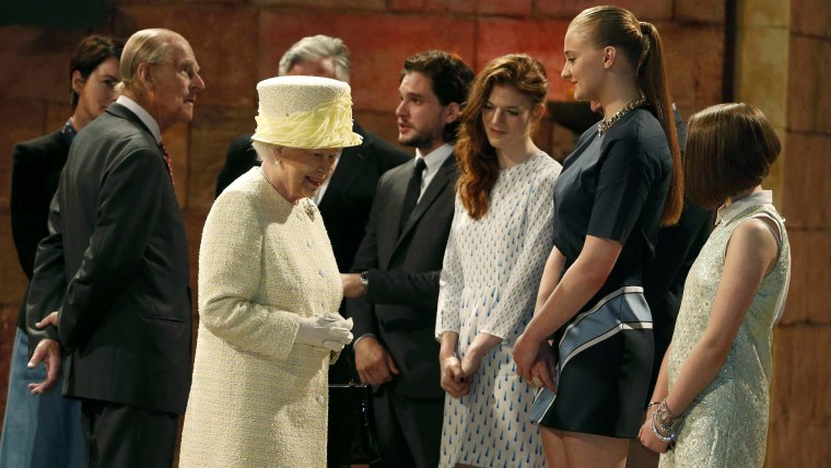 Britain's Queen Elizabeth and Prince Philip talk with members of the cast, including Sophie Turner (2nd R), on the set of the television show Game of ...
