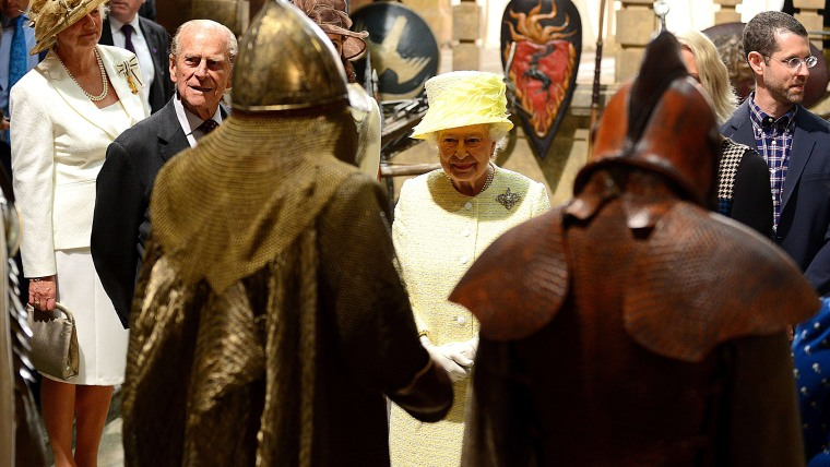 """Britain's Queen Elizabeth II and Prince Philip, the Duke of Edinburgh views props and costumes during their visit to the set of the HBO TV series """"Gam..."""