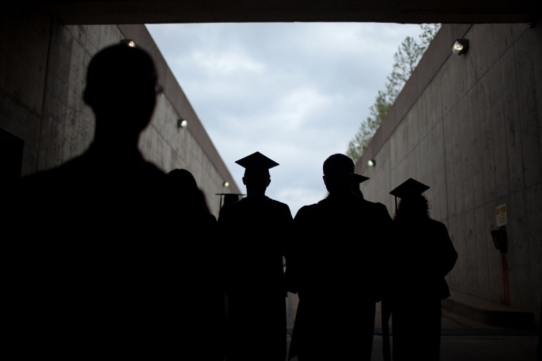 A line of students enter the State Farm Center for commencement ceremonies for the University of Illinois at Urbana-Champaign school of business on Ma...