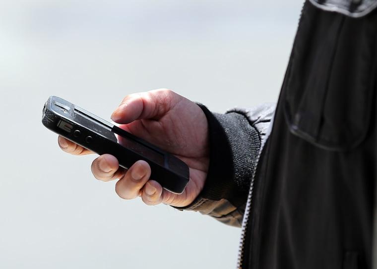 SAN FRANCISCO, CA - JUNE 05:  A pedestrian uses a smartphone as he walks along Market Street on June 5, 2013 in San Francisco, California.  According ...
