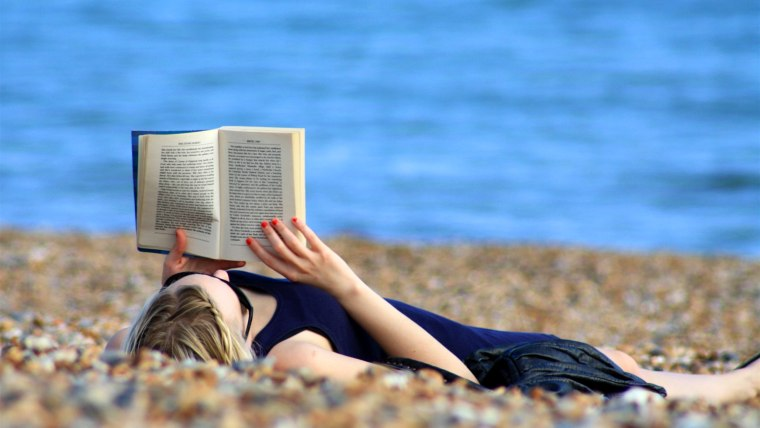 reading, summer, beach, woman, book, msnbc stock photography