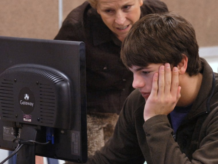 Getting into college is a rigorous process, and that should include looking for the right scholarships. Project Leadership board member and volunteer Jacquie Dodyk, left, helps Tanner Williams and other seniors fill out college application forms in this 2011 photo.