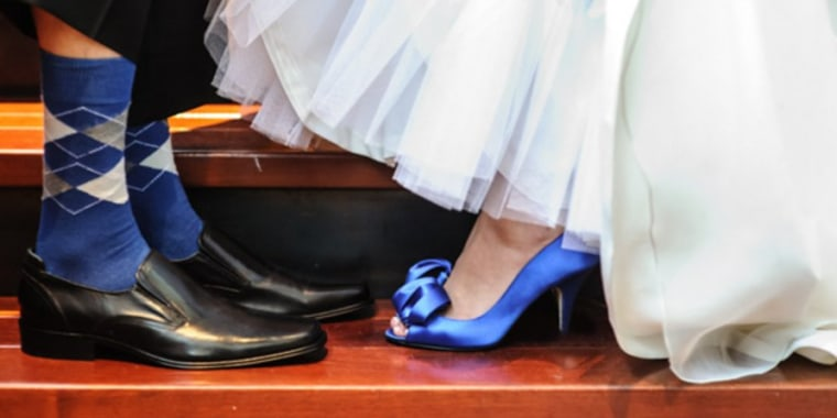 The bride and groom share their blue footwear.