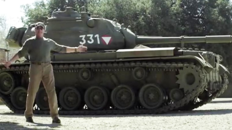 Arnold Schwarzenegger uses tank to crush objects for charity