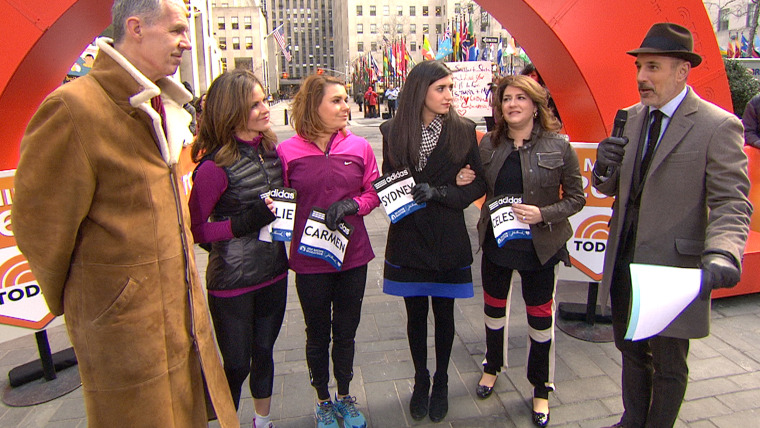 On the TODAY plaza Tuesday, Tom Grilk, executive director of the Boston Athletic Association, presented race bibs to Natalie Morales and Carmen Acabbo, and honorary bibs to Celeste and Sydney Corcoran.