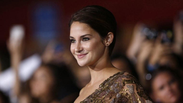 """Cast member Shailene Woodley poses at the premiere of \""""Divergent\"""" in Los Angeles, California, March 18, 2014. The movie opens in the U.S. on March 21...."""