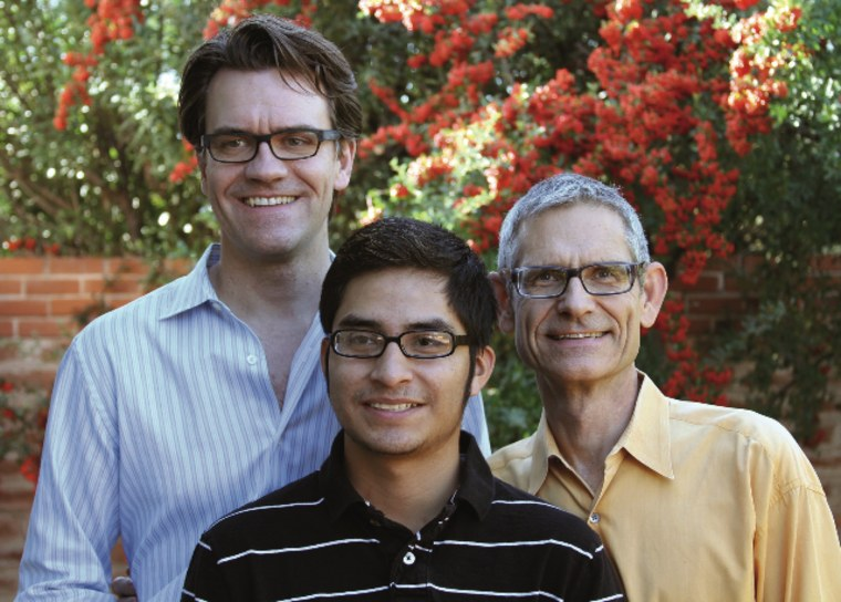 Stephen Russell, left, and partner Scott Neeley, with son Enrique.