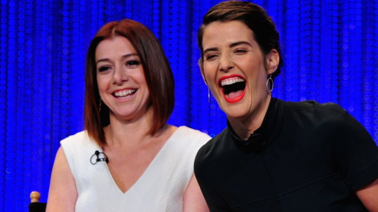 """HOLLYWOOD, CA - MARCH 15:  (L-R)  Actors Alyson Hannigan and Cobie Smulders on stage at The Paley Center For Media's PaleyFest 2014 Honoring """"How I Me..."""