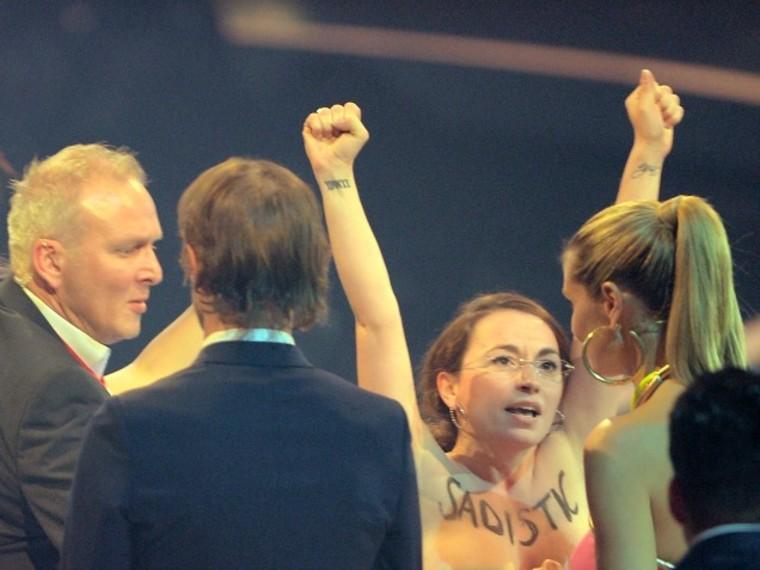 Heidi Klum Ambushed By Topless Protestors on Germany's Next Top Model