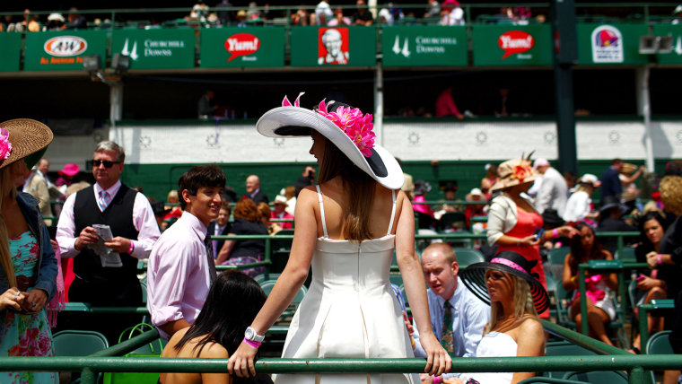 Madelynne Myers of Louisville, Kentucky wears a derby hat with her friends on Kentucky Oaks day on the eve of the 137th Running of the Kentucky Derby ...