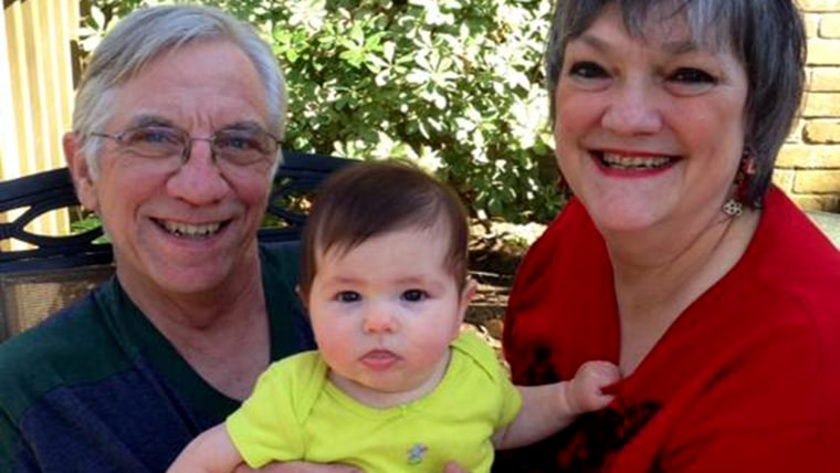 """Kelly and Linda Younger of Houston, Texas, hold their granddaughter Molly. """"Kelly and I are smitten,"""" Linda Younger said of the girl, who was born las..."""