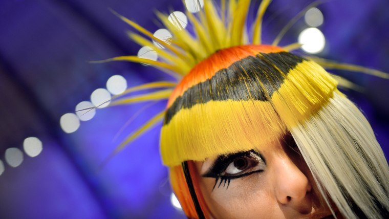 A model waits after the contest 'Full Fashion Look' for the rating of the jury during the OMC Hairworld World Cup in Frankfurt am Main, Germany on May 4.