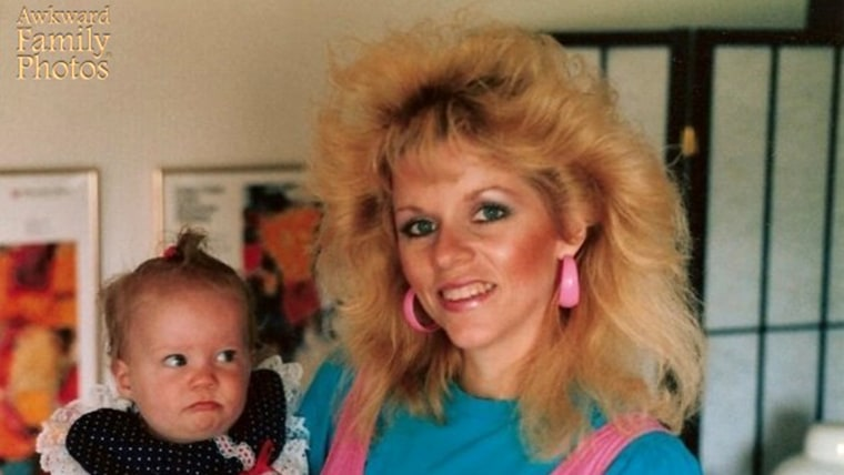 Image: Awkward Family Photo of a mom with wild hair holding a baby