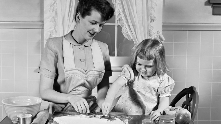 1950s MOTHER  DAUGHTER BAKING TOGETHER IN KITCHEN CUTTING DOUGH WITH COOKIE CUTTERS  /H. ARMSTRONG ROBERTS/CLASSICSTOCK/Everett Collection