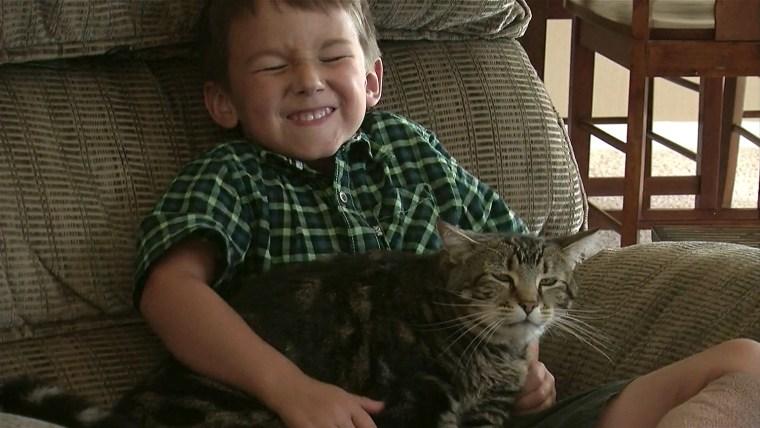Jeremy Triantafilo with hero cat, Tara