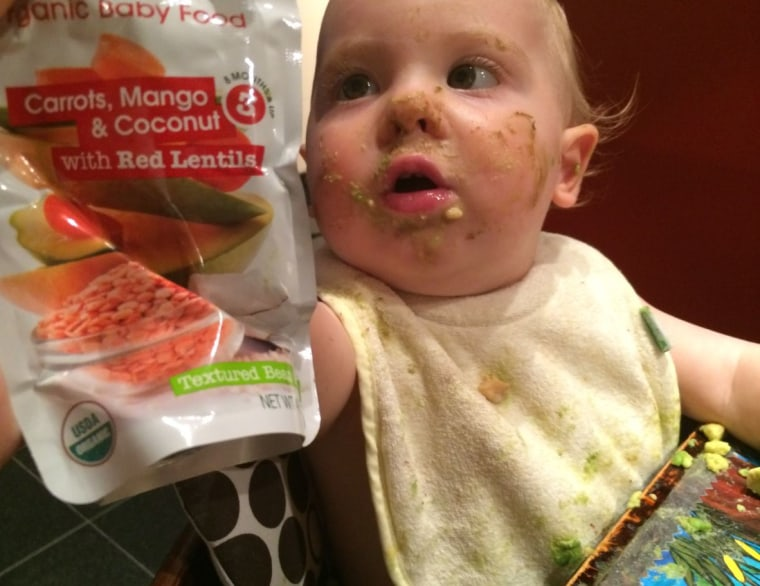 Joseph, 12 months, enjoys a dinner of organic carrots, mango, coconut and red lentils.