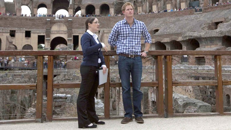 Britain's Prince Harry listens to Italian guide Laura Ciglioni as he tours the Colosseum in Rome May 19, 2014. REUTERS/...