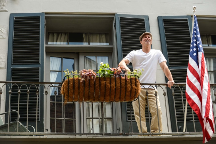 NEW ORLEANS, LA - MAY 17:  Actor Brad Pitt greets Matthew McConaughey from his New Orleans balcony on May 17, 2014 in New Orleans, Louisiana.  (Photo ...