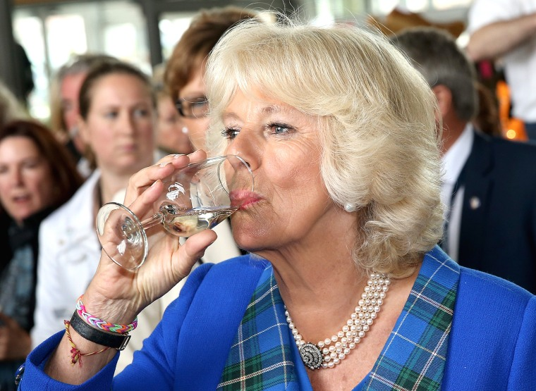 HALIFAX, USA - MAY 19:  Camilla, Duchess of Cornwall tastes some wine as she visits Seaport Farmer's Market on May 19, 2014 in Halifax, Canada. The Pr...
