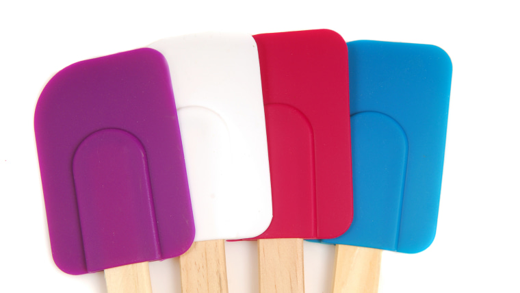 Four rubber and silicone spatulas in different colors