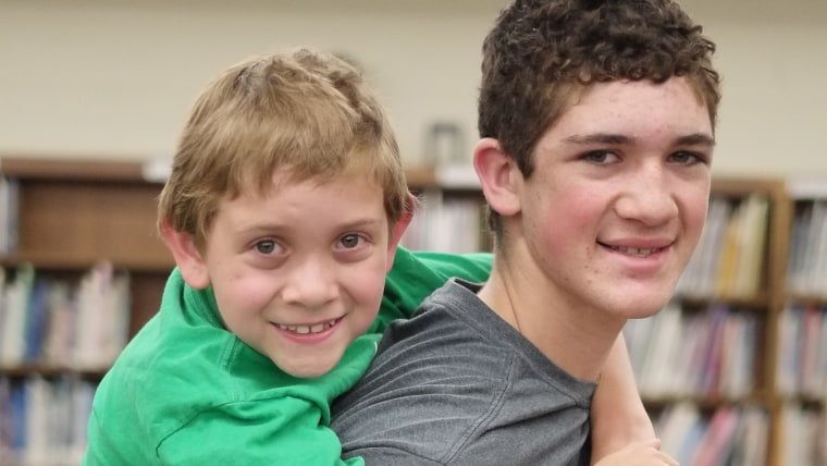 Hunter Gandee, 14, and his brother Braden Gandee, 7, Thursday, May 8, 2014, at Bedford Junior High School in Bedford, Mich. The two will be making a w...