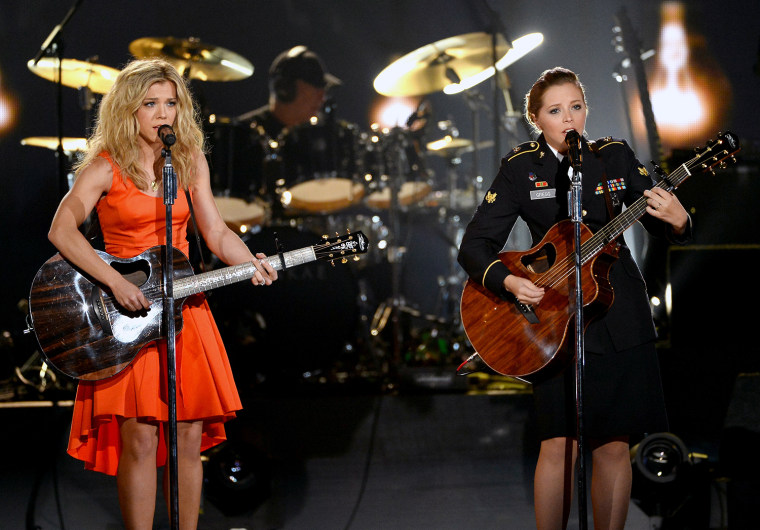 Kimberly Perry performs with Army Spc. Kelly Gregg.