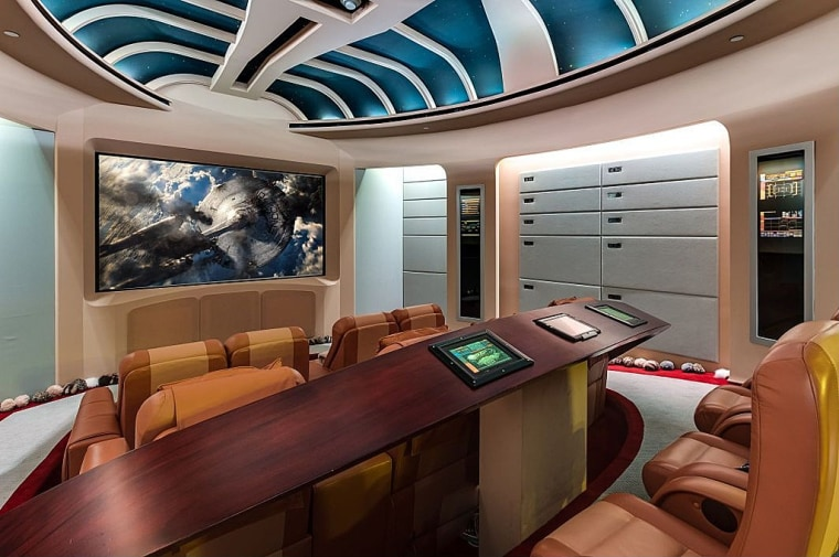 """On the bridge of the Starship Enterprise? Not exactly, but you could watch all the \""""Star Trek\"""" episodes in this theater room."""
