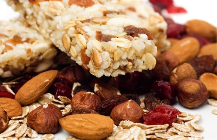 Granola bar with dried fruit and nuts on white background. Cereal bar, organic, nuts, fruit, healthy, diet, food,