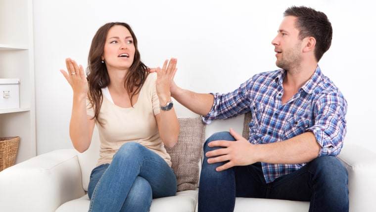 Portrait Of Frustrated Couple Sitting On Couch Quarreling With Each Other; Shutterstock ID 166288778; PO: TODAY.com
