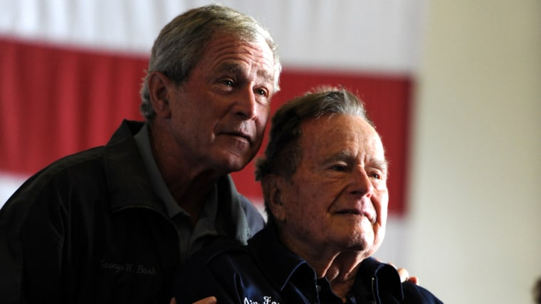 Former Presidents George W. Bush, left, and his father, George H.W. Bush.