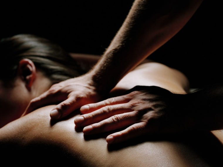 Young woman recieving back massage at spa, close-up, msnbc.com, stock, photography