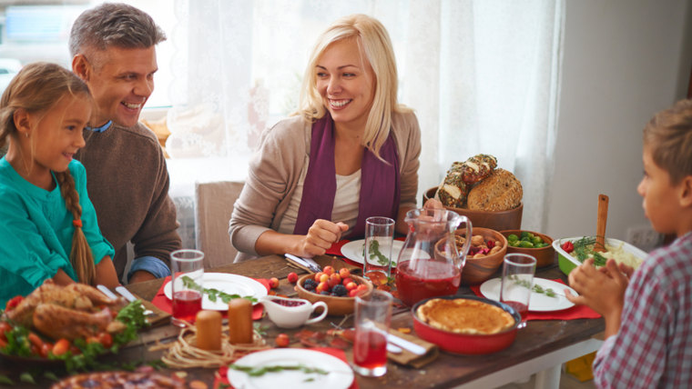 Happy family of four celebrating Thanksgiving day; Shutterstock ID 225143923; PO: TODAY.com