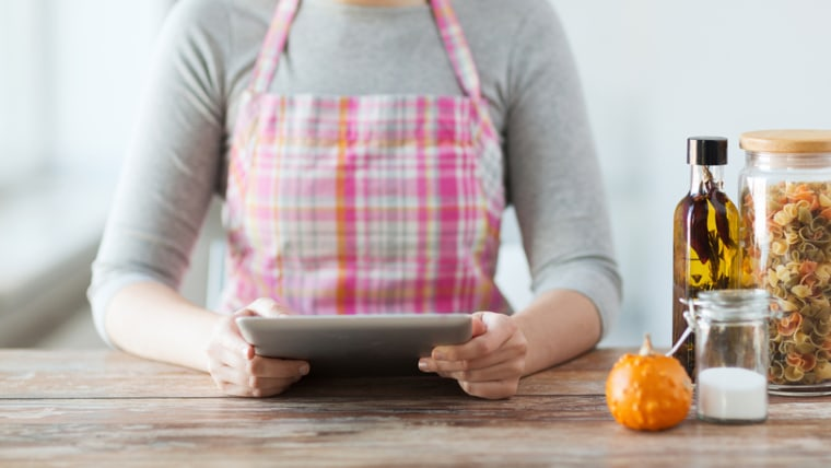 cooking, technology and home concept - closeup of woman reading recipe from tablet pc computer; Shutterstock ID 177815708; PO: TODAY.com