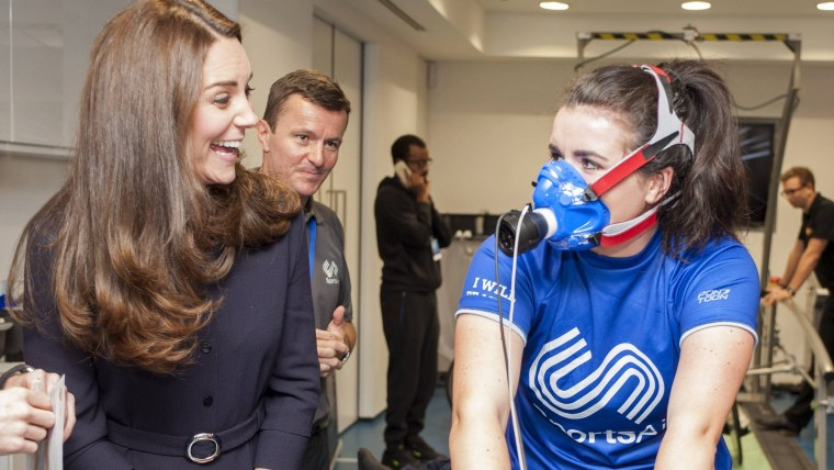 Britain's Catherine, Duchess of Cambridge (L) speaks with young athlete Emma Allen during her visit to a SportsAid workshop at the GlaxoSmithKline (GS...