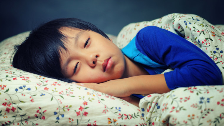 Cute boy trying to fall asleep (eyes slightly opened); Shutterstock ID 119317180; PO: today.com; Job: qzzr