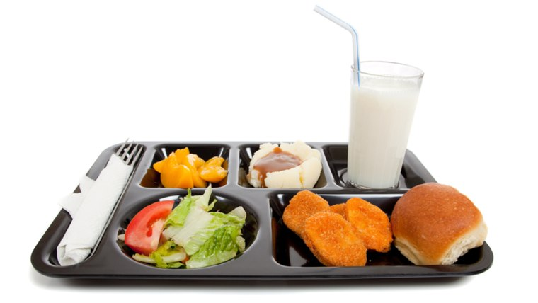 A school lunch tray on a white background with copy space; Shutterstock ID 38230963; PO: today.com