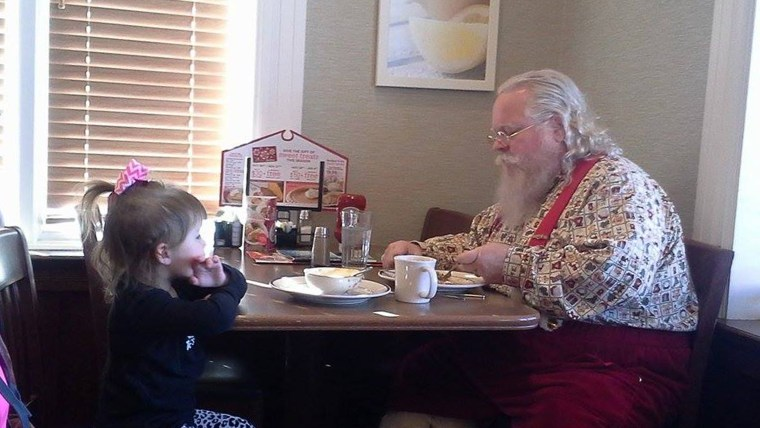 Little Gracie thought that Santa might be lonely, so she pulled up a chair to keep him company.