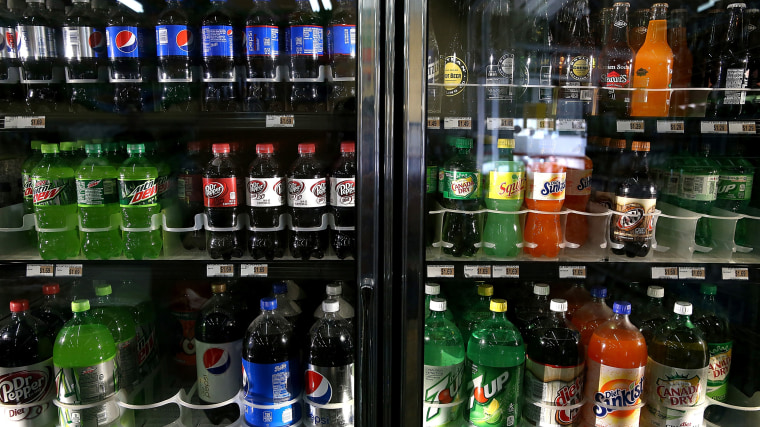 Various bottles of soda are displayed