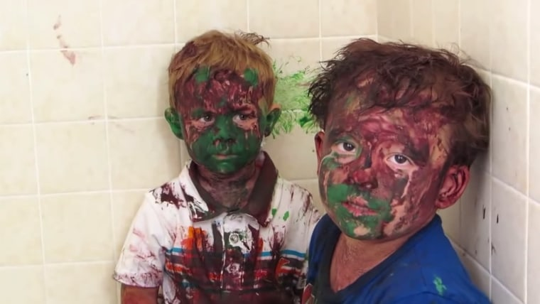 Image: Dad catches painted sons