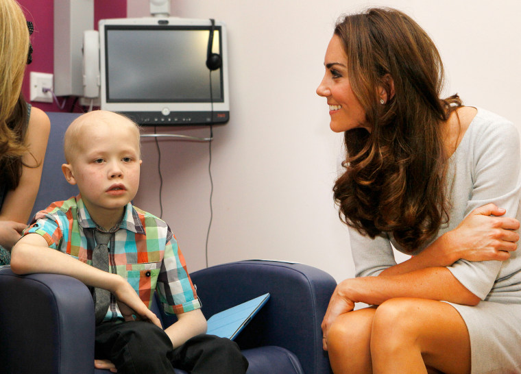 Britain's Duchess of Cambridge meets patient Fabian Bate, 9, during a visit with her husband Prince William  to the new Oak Centre for Children and Yo...