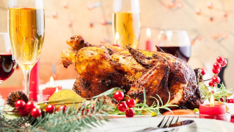 Baked turkey for Thanksgiving dinner on festive table; Shutterstock ID 222362743; PO: today.com