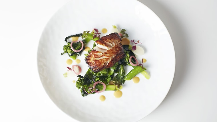 Dish arranged on a white plate, by chef Charlie Palmer