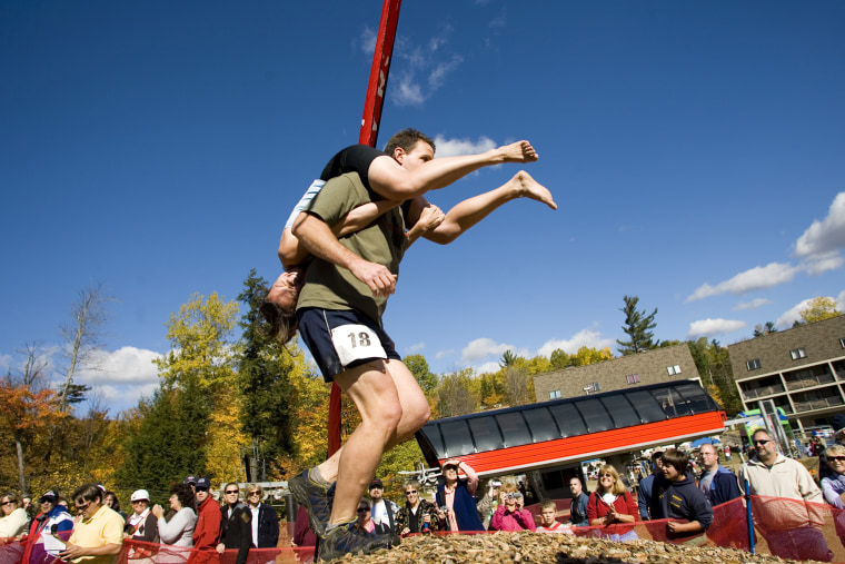 Image: Competitors at the North American Wife Carrying Championship